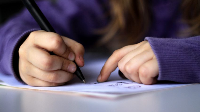 https://commons.wikimedia.org/wiki/File:A-kid-drawing-or-writing.jpg